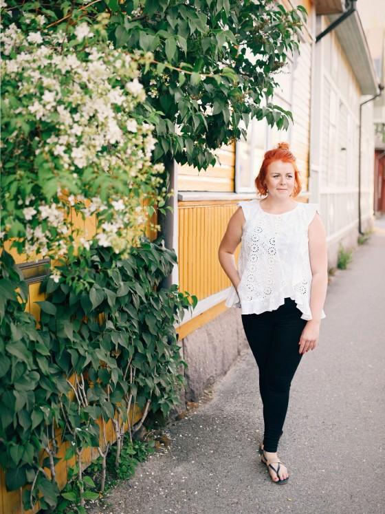 Woman walking down the street in Kokkola museum quarters