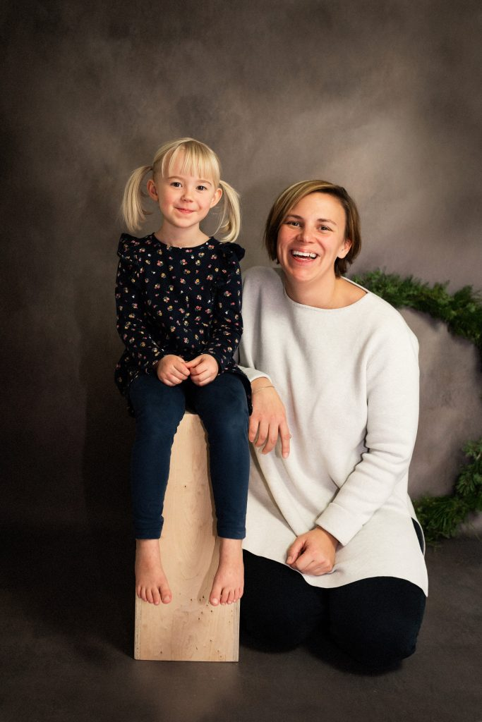 Studio portrait of daughter and mother